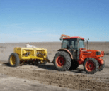 Tractor pulling a drill seeder